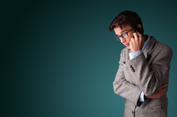 Young man making phone call with copy space