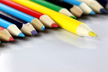 Several colored of crayon is arranged on white.