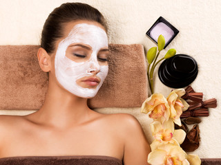 Beautiful woman with mask on her face relaxing.