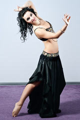 Dark-haired girl performing a belly dance