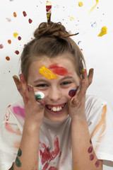 Smiling girl with paint on her face