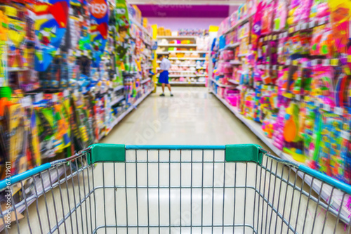 Shopping cart in toys department store - 67319611