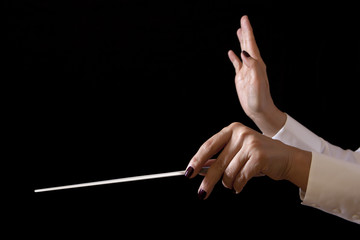 Music female director holding stick