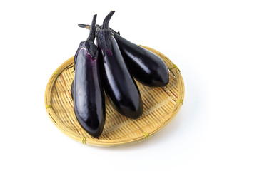 Japanese eggplant on the colander with white background
