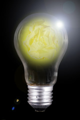 Crumpled Yellow paper inside lamp bulb