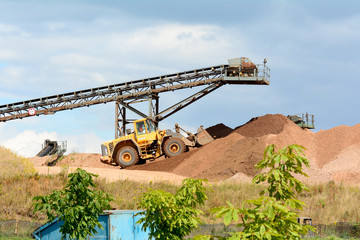 Quarry work - stone piles with machinery