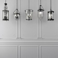 Decorative hanging lamps against a white wall
