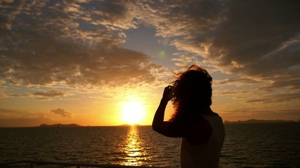 Girl Photographing Sunset from Sailing Ferry. Motivational