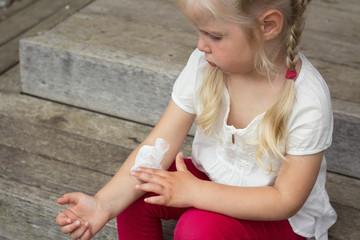 Girl applying dermatology cream on skin