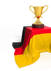 Golden trophy with German flag isolated on white