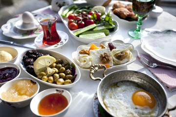 Rich and delicious Turkish breakfast on a round table