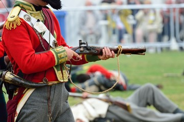 Redcoat firing Musket in re-enactment