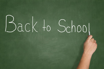 Hand writing Back to school text on blackboard