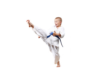 High kick leg in performance  sportsman with a blue belt