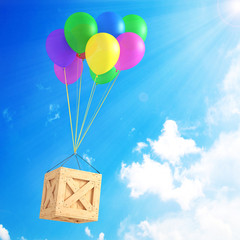 Multicolored air balloons with box on sky background