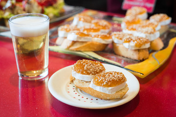 Pinchos, traditional Basque Country appetizer. Served with beer