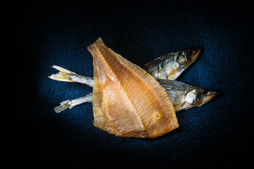 Dry fish on dark background