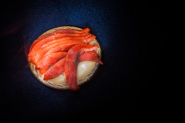 Salted salmon on clay saucer