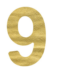 number made from beige paper on a white background