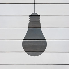 bulb silhouette in wooden boards