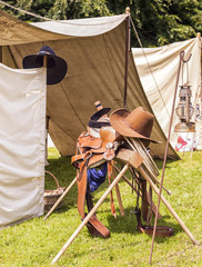 American cowboy hat,  with horse saddle, and lasso  rope, at a c