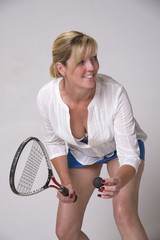 Female squash player holding ball and racquet