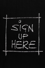 The phrase Sign Up Here written on a blackboard