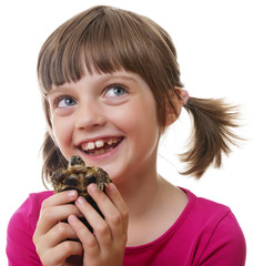 little girl holding a pet turtle