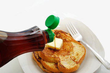 Pouring Maple Syrup on Hot Fresh French Toast