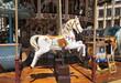 Leinwanddruck Bild - Holzpferd auf Karusell