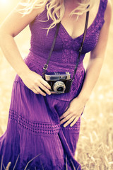 woman purple dress camera