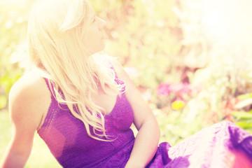 blond woman summer garden