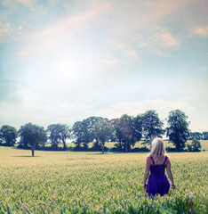 blond woman in crop field
