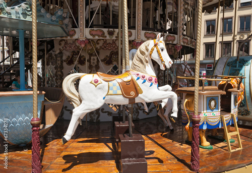 canvas print picture Holzpferd auf Karusell
