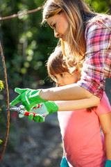 Mother and daughter  gardening together.Family concept.