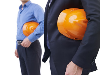 men with orange safety hat on white background