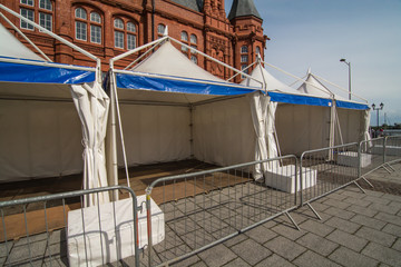 A row of static display tents, in readiness for a public event
