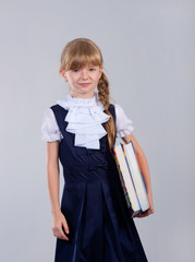 Cute beautiful schoolgirl with books and globe