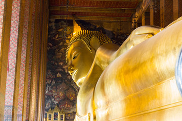 The Big golden Reclining Buddha within Wat Pho is the important