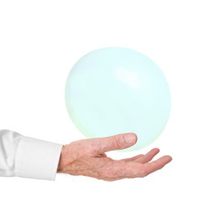 Older man in business shirt catches bubble. Fragility concept.