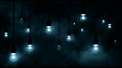 Incandescent bulbs hanging, smoke in motion, dark blue