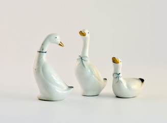 Ceramic figurines of geese.