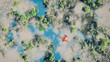 Aerial of red airplane flying over forest with lakes and clouds. - 67338074