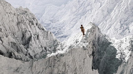 Aerial perspective of hiker standing on peak in snow mountain la