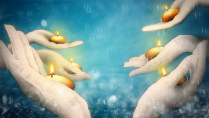 Number of ride hands holding candles, water droplets background