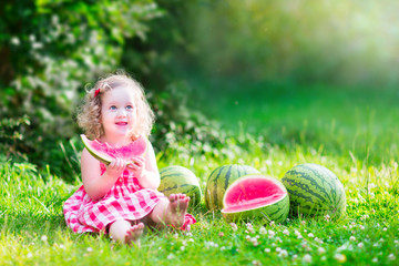 Little beautiful girl eating watermelon