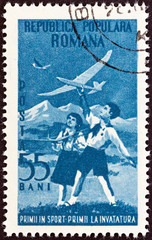 Boy and girl flying model gliders (Romania 1953)