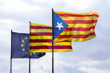 Flags of European Union and Catalonia with the Catalan secession