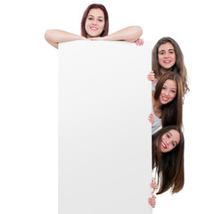 Teen girls holding blanc billboard