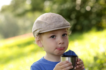 Child with cup of tea